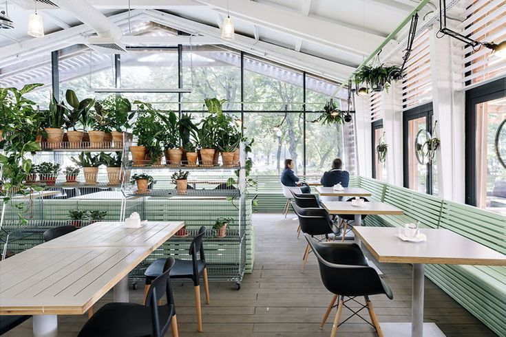 Glass walls make the most of the Gorky Park scenery at Crosby Studio's green house...
