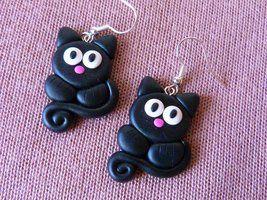 Black cats by amalie2 IDEA