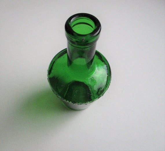Old green bottle: shabby chic vintage De Kuyper bright green glass alcohol bottle, medicine, pharmacy, drinks bottle, pharmacy bottle