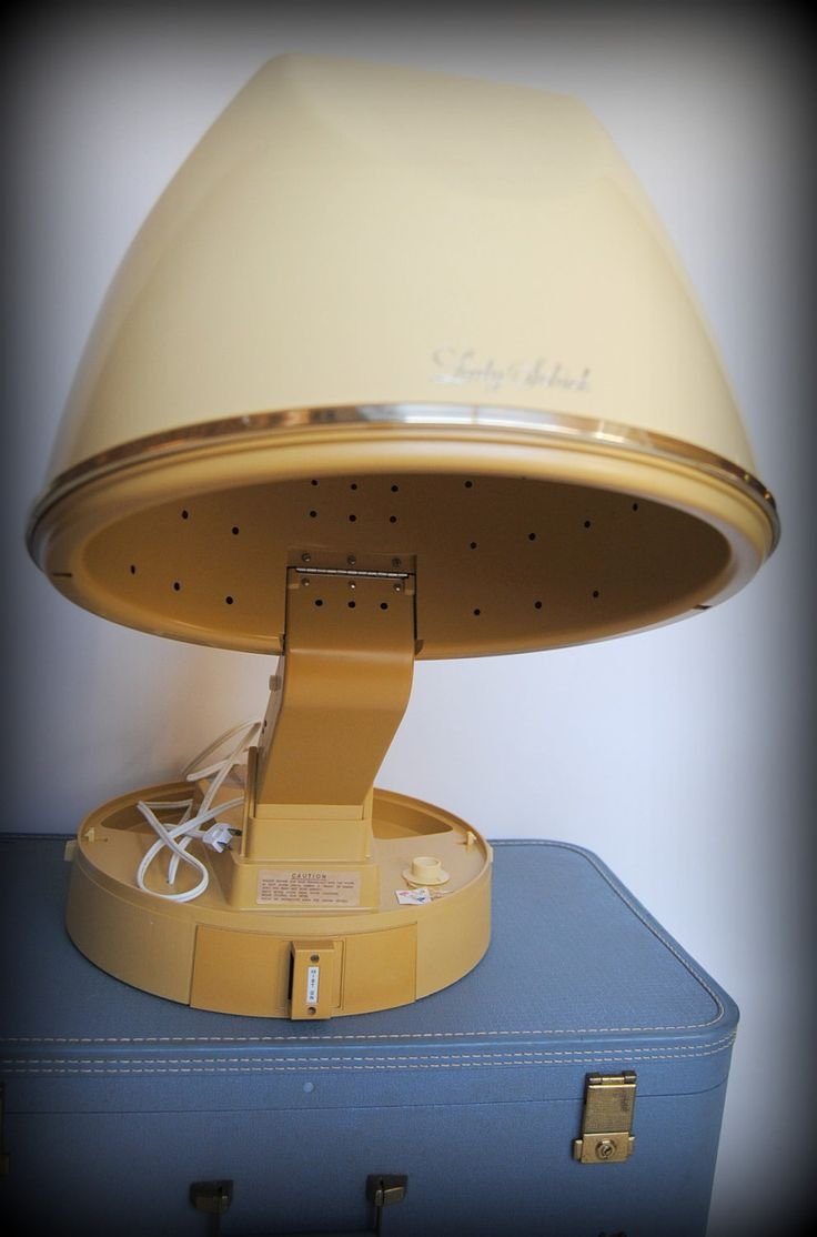 My Mom, Grandma and Aunts sat under one of these with curlers in their hair when I was little. I always loved watching them fix their hair.