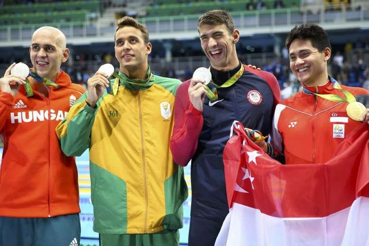 Joseph schooling with 3 joint silver medallist. He won it IN STYLE!