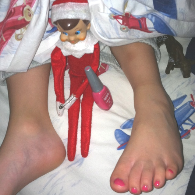 Our elf painted my son's toenails while he slept...