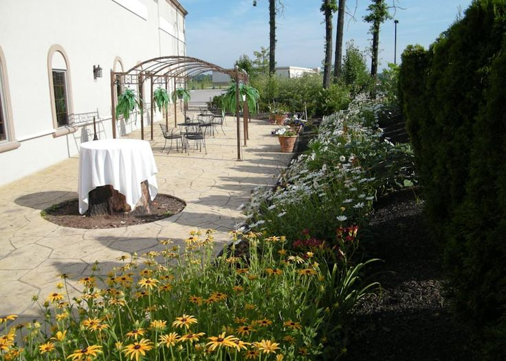 Our beautiful stone patio area with lighted pergola. Columbus Ohio Wedding Reception Venues | Brookshire Facility