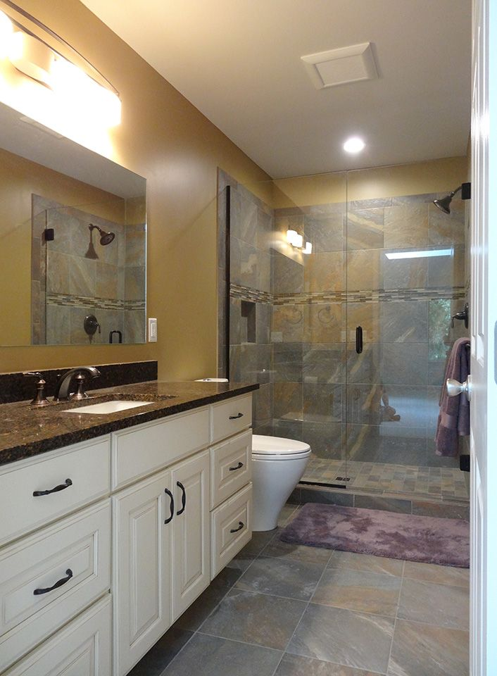This Ann Arbor Bathroom Remodel Features Ayers Rock Porcelain Tiles Medallion Cabinetry And