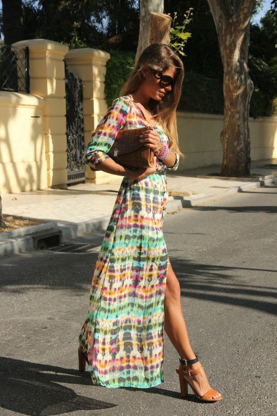 Maxi dress with a Southwest Aztec feel to it. Don't you just love her leg showing through the slit in this skirt.