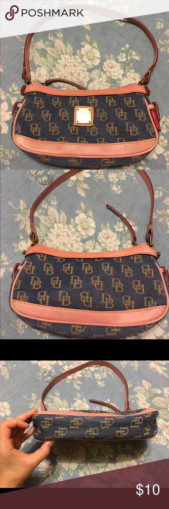 Small Dooney and Bourke denim handbag. Small Dooney and Bourke denim handbag. Handbag is dirty from inside, clean from outside. There is discoloration to the leather, leather is pink. Price is firm. Dooney & Bourke Bags