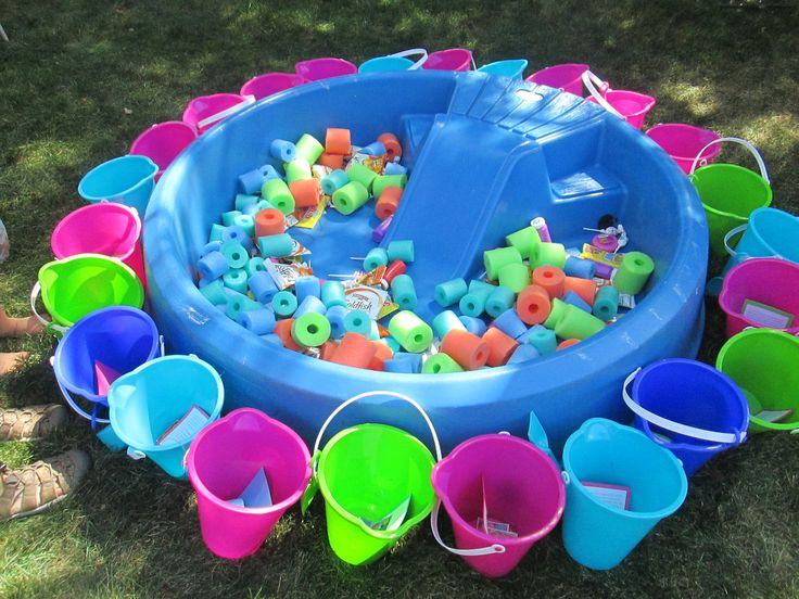 Fill a baby pool with cut up pool noodles and goody bag treats and let each kid take a pail and go 'fishing' for their party treats. I filled the pool with gold fish, swedish fish, blow pops, bubble gum, and bubbles.