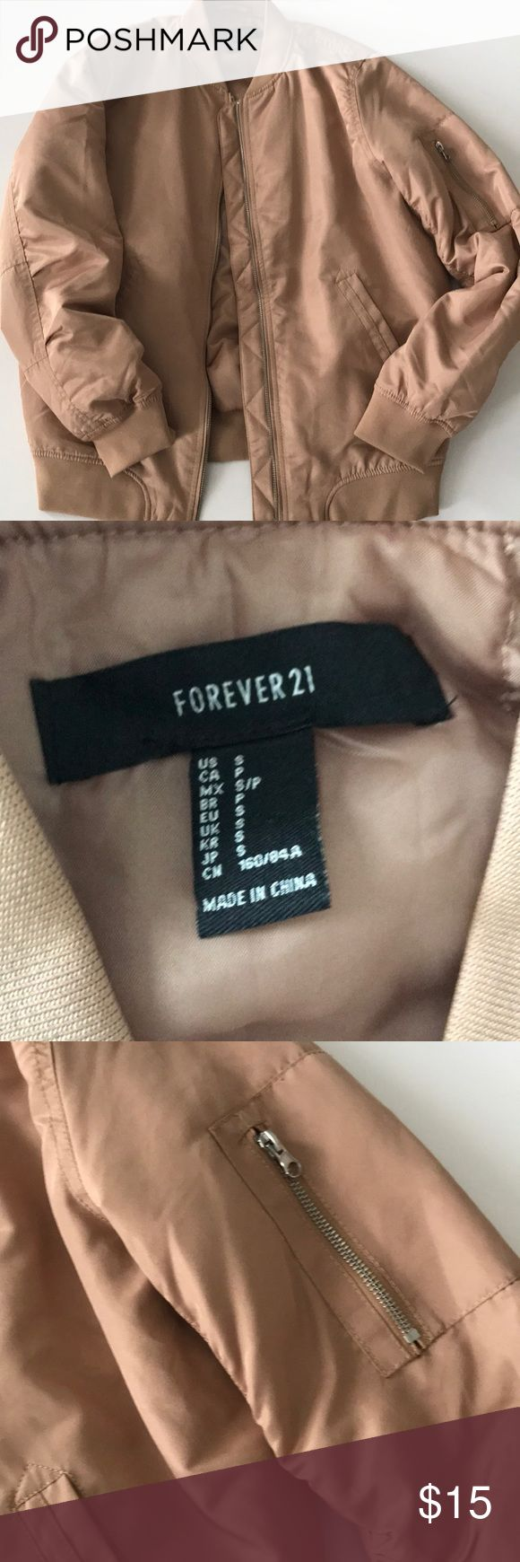 Forever 21 Tan Bomber Jacket Sz S Forever 21 Tan Bomber Jacket Sz S. Brand New, never worn. Tiny stain on bottom left by zipper (must have happened during transport). Haven't tried washing it since it's brand new. Great Jacket, just haven't had a chance to wear it so it's time to get rid of it. Forever 21 Jackets & Coats