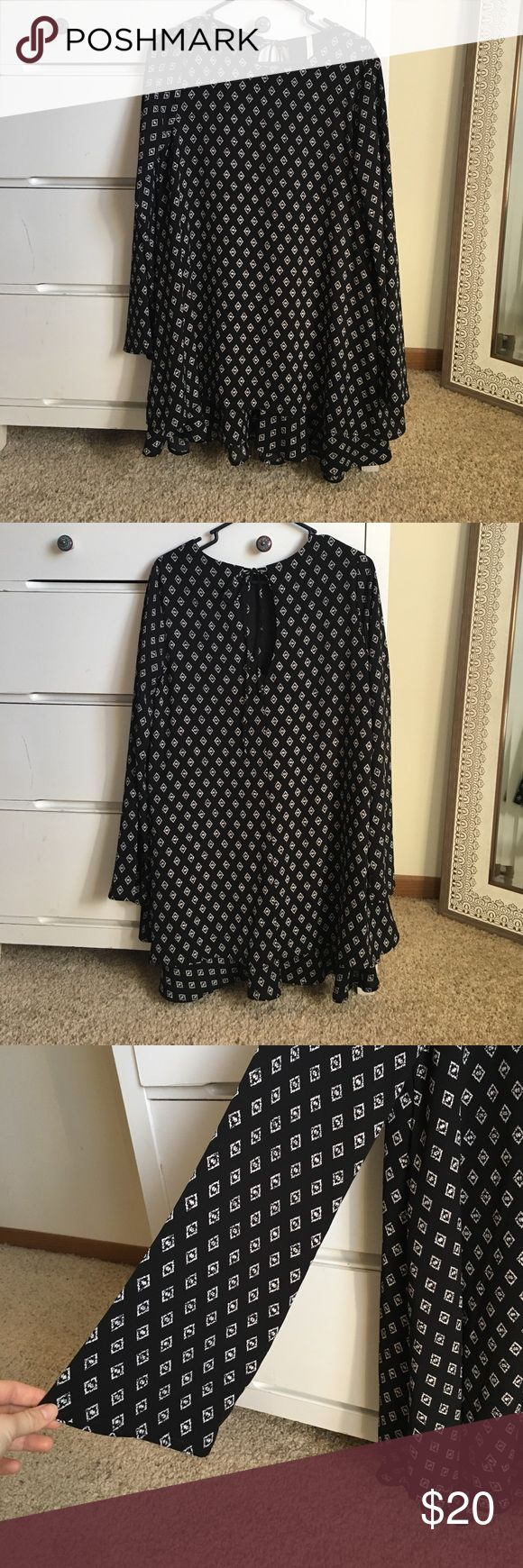 """Patterned Bell Sleeve Dress Purchased from Wish Boutique out of South Carolina. Adorable patterned dress with added layer of frill at the bottom, key hole tie back, and gorgeous bell sleeves. This dress has a modest neckline with a little bit of a tease. I am 5'4"""" and it hit me 2 inches above my knee cap without a belt, and mid thigh with a belt. Worn twice. NO RIPS ! Sage Dresses Long Sleeve"""