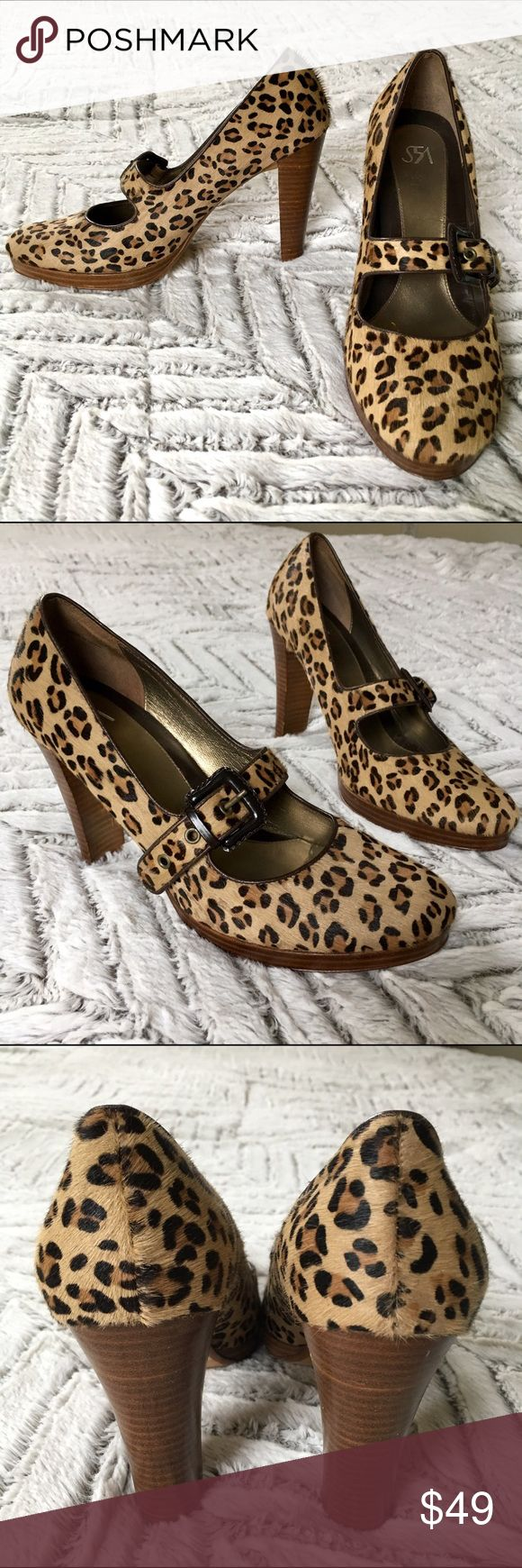 """Saks 5th Ave Pony Hair Mary Jane Chunky Heels, 10 Gorgeous Saks 5th Avenue Leopard Print Pony (calf) hair Mary Jane Chunky Platform Heels, size 10M. In good pre-owned condition with some visible signs of wear: scratches on wood platforms and heels, wear on soles, some patches in Pony hair. So much life left-- a really beautiful pair of shoes. Please see photos for best description of condition. 1/2"""" Platform, 4.5"""" heel. Saks Fifth Avenue Shoes Heels"""