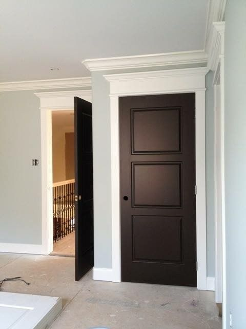 I'm loving the colors being used in this home. White trim, pale blue walls and black doors. Classic.