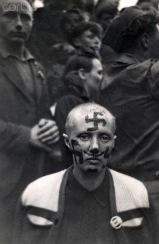 A shaved woman during the liberation of  France. 1944. Re-pinned by www.historysimulation.com