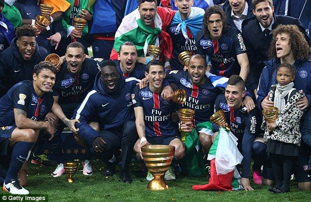 PSG stars pose for a team photo as they celebrate their 2-1 win over Lille in the French League Cup final