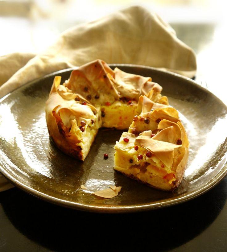 Tyropita (cheese pie) with yellow cheeses