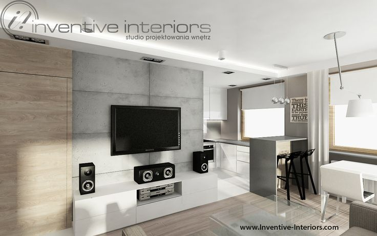 Projekt mieszkania Inventive Interiors - beton na ścianie TV