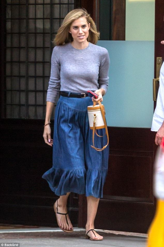 Chic:Allison Williams looked stylish in a flouncy denim skirt as she left her hotel in Ne...