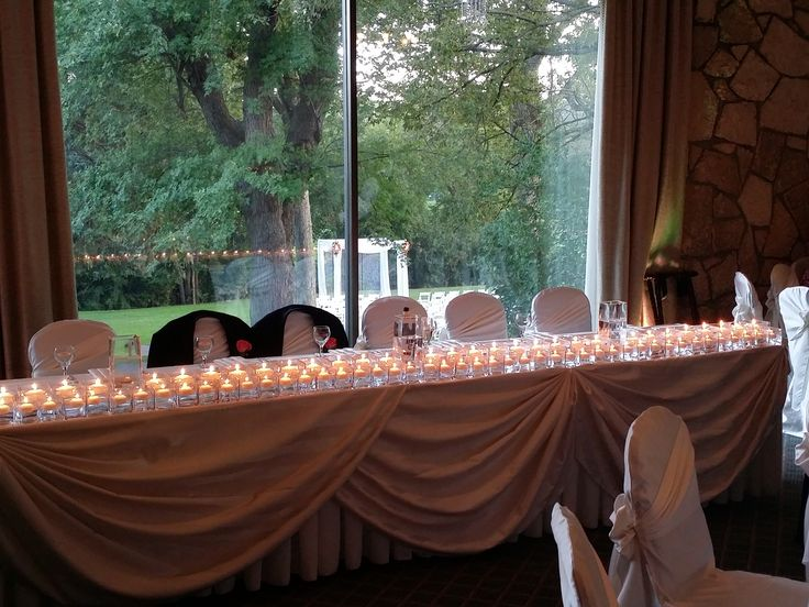 Beautiful Head Table Lit Up With A Ton Of Floating Candles Small Square Vase In