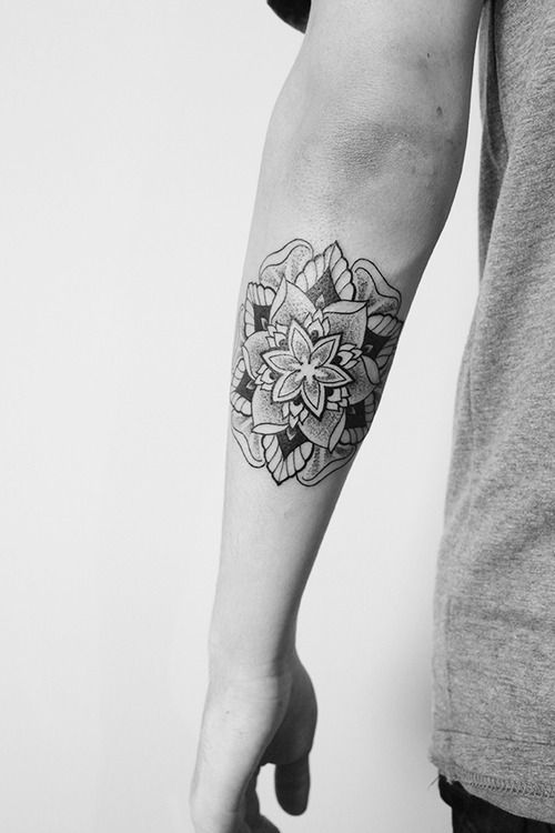 Blackwork mandala tattoo