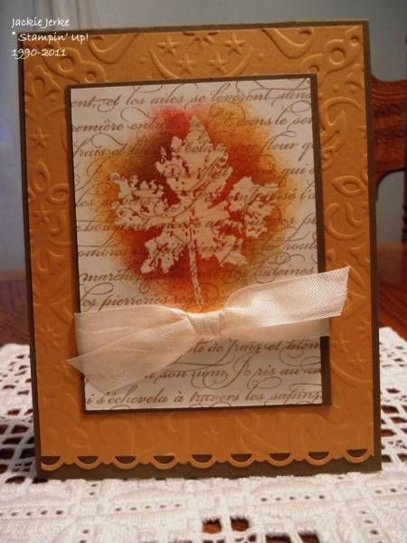 By Jackie Jerke (JJ Rubberduck on Splitcoaststampers). Stamp leaf in VersaMark on white cardstock. Sponge around leaf image. Stamp text on top of everything. Add bow, mats. She ran the orange mat through the Cuttlebug and punched the lower edge with a decorative punch. Nice!