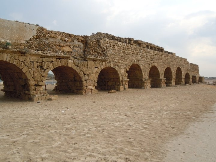 Caesarea Maritima - The Aqueduct, which provided an abundant supply of water, was built in the Herodian period; it was later repaired & enlarged to a double channel when the city grew. The upper aqueduct begins at the springs located some nine kilometers northeast of Caesarea, at the foot of Mt. Carmel. It was constructed with considerable engineering know-how, ensuring the flow of water, by gravity, from the springs to the city. In some portions, the aqueduct was supported by rows of arches