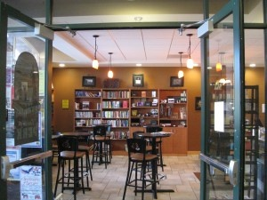 library coffee shop, this is the best example I've found yet. Note the cafe tables, the books and warm lighting.