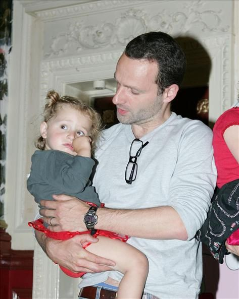 Andrew Lincoln carrying his daughter Matilda Clutterbuck?