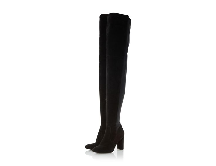 This sensual over the knee boot makes the ultimate style statement. With a high chunky heel, decorative corset detail and inside zip fastening. The stitch panel detail and rounded toe complete this show-stopping style.