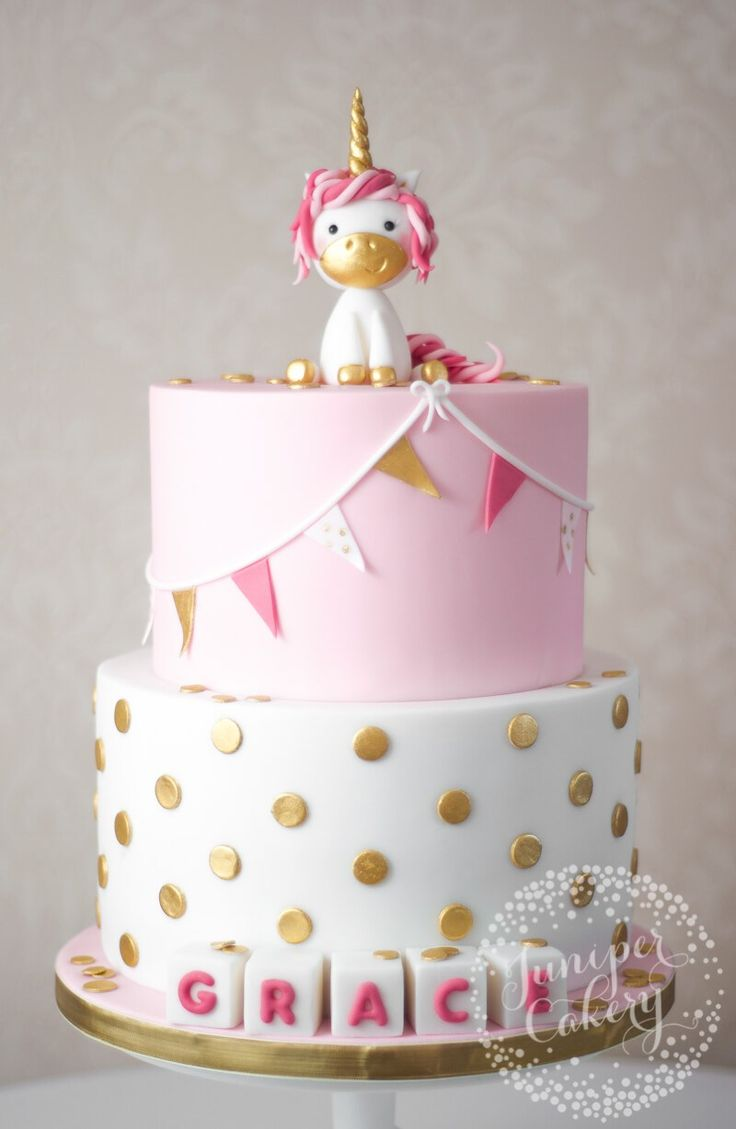 Adorable pink, white and gold unicorn Christening cake by Juniper Cakery