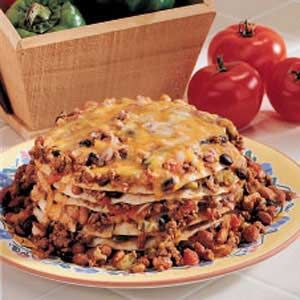 Slow Cooker Enchiladas Recipe    (I would dispense with the hamburger personally-- being vegetarian)