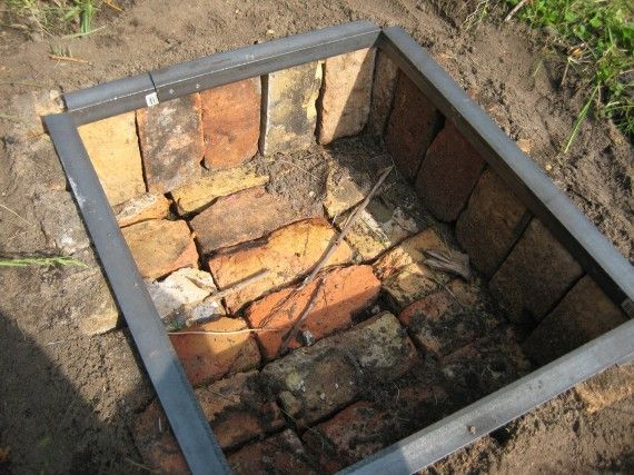 A Metal Frame Fire Pit .. recycled bricks by The Farmer I want a Topper on mine but it is Quick