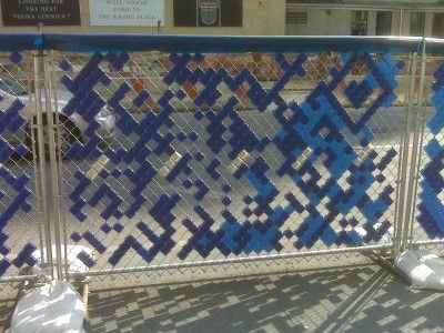 Secret urban messages (QR codes made in fences with plastic blocks....on the corner of Houston and Broadway in Manhattan)