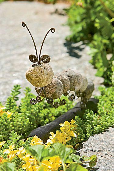 Stone caterpillar sculpture