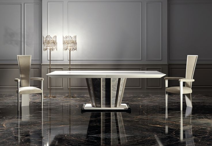 The impressive and superb capital table manufactured with the latest technologies spreads pure elegance in your dining room. #vismaradesign #table #diningroom #luxury