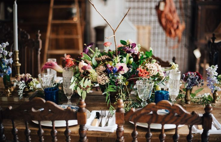 Woods & Bloom created this richly coloured blooms, fruit and vintage brass boho table arrangement to evoke a dark romantic feel for a wedding ceremony