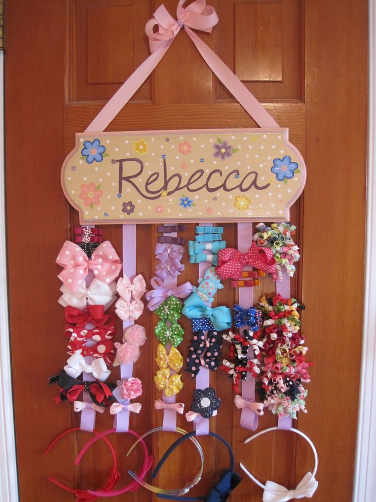 In case you're not sure exactly what these things are for, here is one in action. It keeps all of your little girl's bows and headbands organized and off of the floor and the dresser. We can match the designs in her room and add her name- find us on facebook and etsy!   facebook.com/spoonfuldesigns  etsy.com/spoonfuldesigns