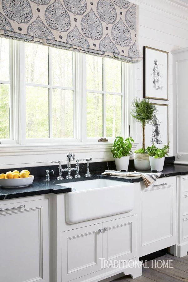 Soapstone countertops contrast with a Rohl Shaws fireclay sink with a vintage-style chrome Rohl Perrin & Rowe faucet. - Photo: Jean Allsopp / Design: Dana Wolter