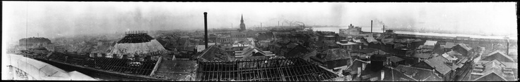 1915 hurricane damage in Quarter - from the roof of the court bldg downriver - Napoleon House to the right - Cathedral in the distance - brewery on the river...