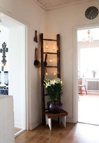 .Love the ladder with candles hanging