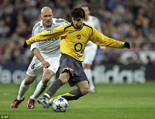 Cesc Fabregas protects the ball from Real Madrid's Thomas Gravesen as Arsenal bossed the B...