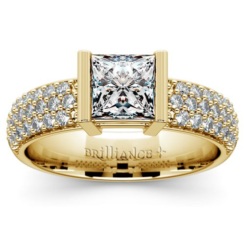 Flip that ring box open and watch her marvel at the charm of the Half Bezel Diamond Engagement Ring in classic Yellow Gold, featuring an exquisite Princess-cut center diamond and 38 shimmering pave-set round diamonds! http://www.brilliance.com/engagement-rings/half-bezel-diamond-ring-yellow-gold-3/8-ctw