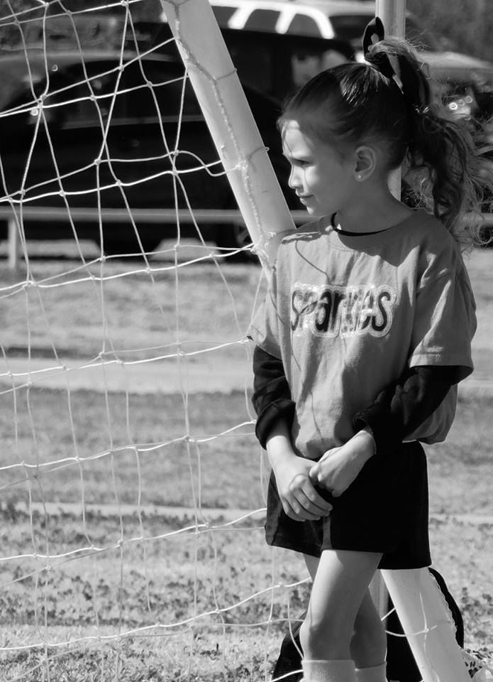 watching her teammates as she takes a break