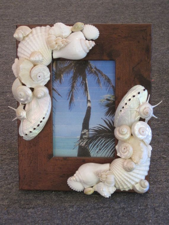17 best ideas about seashell picture frames on pinterest for Ideas for displaying seashells