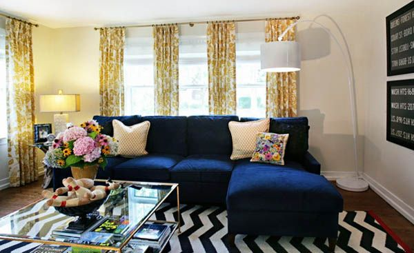 blue soffa, white-blue floor rug and yellow curtains