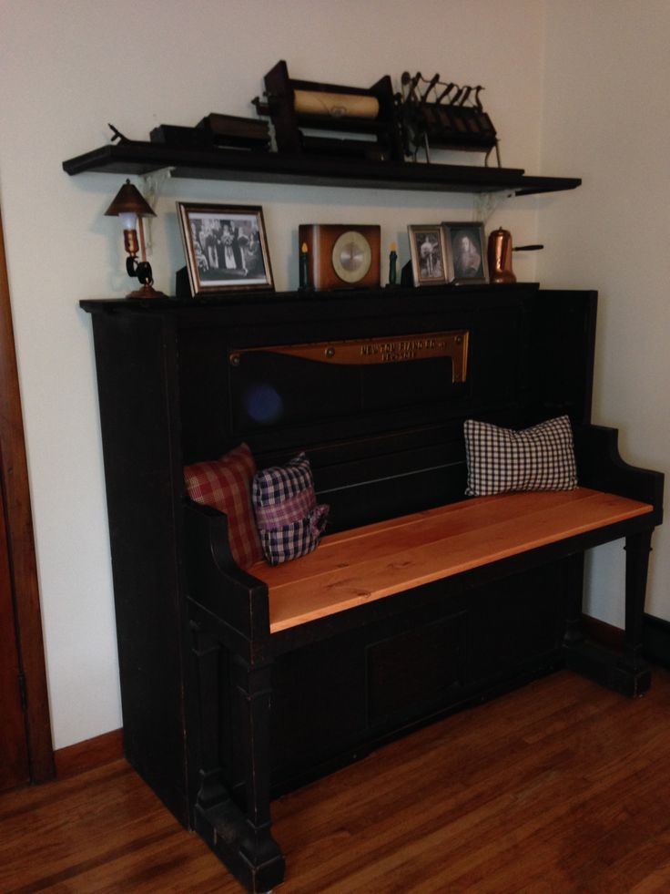 1915 Newton Player Piano repurposed it into an entryway bench. The piano top was used for the shelf shown above to display the player piano roll mechanism.