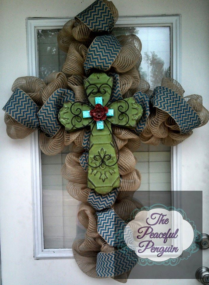 Saw a very pretty one similar to this on Duck Dynasty (theirs had leopard print & feather accents). I'd like to make one in black with silver flourishes. Wonder how hard it is to find a cross shaped wreath frame? Burlap Mesh Cross Wreath with Green Tin by ThePeacefulPenguin