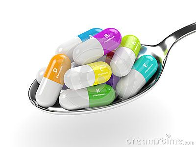 3d rendering of vitamin pills on spoon over white background