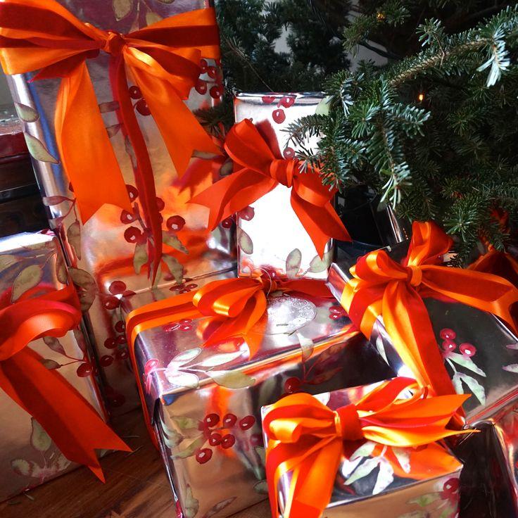 red and orange christmas gift wrap. grosgrain and velvet ribbon. #whitespacesdesign http://www.whitespacesdesign.com