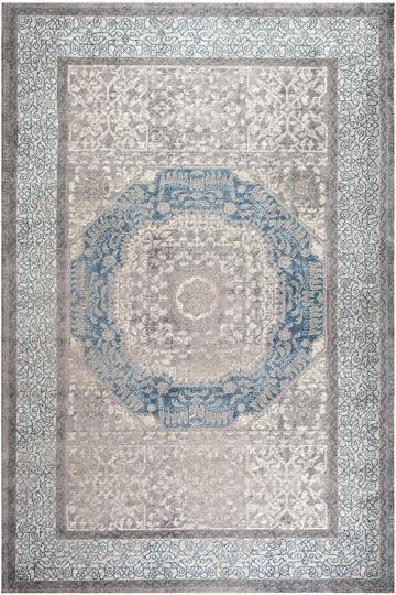 Nicolette Area Rug - with light blue walls and dark gray couch