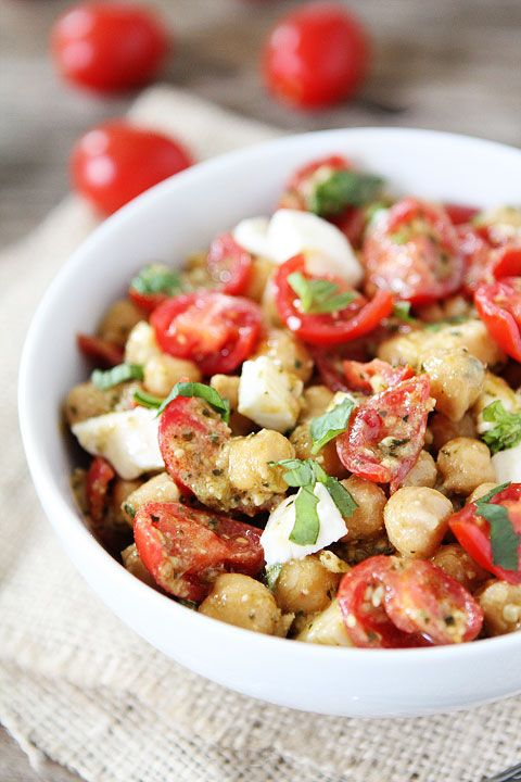 Chickpea, Pesto, Tomato, and Mozzarella Salad Recipe on twopeasandtheirpod.com Only 4 ingredients needed to make this healthy salad! #salad