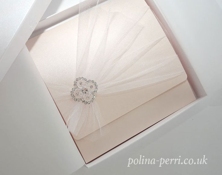 Diamonds & Tulle Pink Wedding  Invitations: These gorgeous tulle wedding invitations will add a definite wow factor to your wedding style. Blush pink, delicate tulle and sparkling diamonds create a distinctively unique look. Asymmetric veil drapes accentuated with a silver metallic brooch with a scattering of sparkling crystals add a flirtatious touch to the design of the invite.